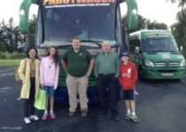 Mike in the middle, the driver of the World's Funniest Bus, Cork, Aug.2014
